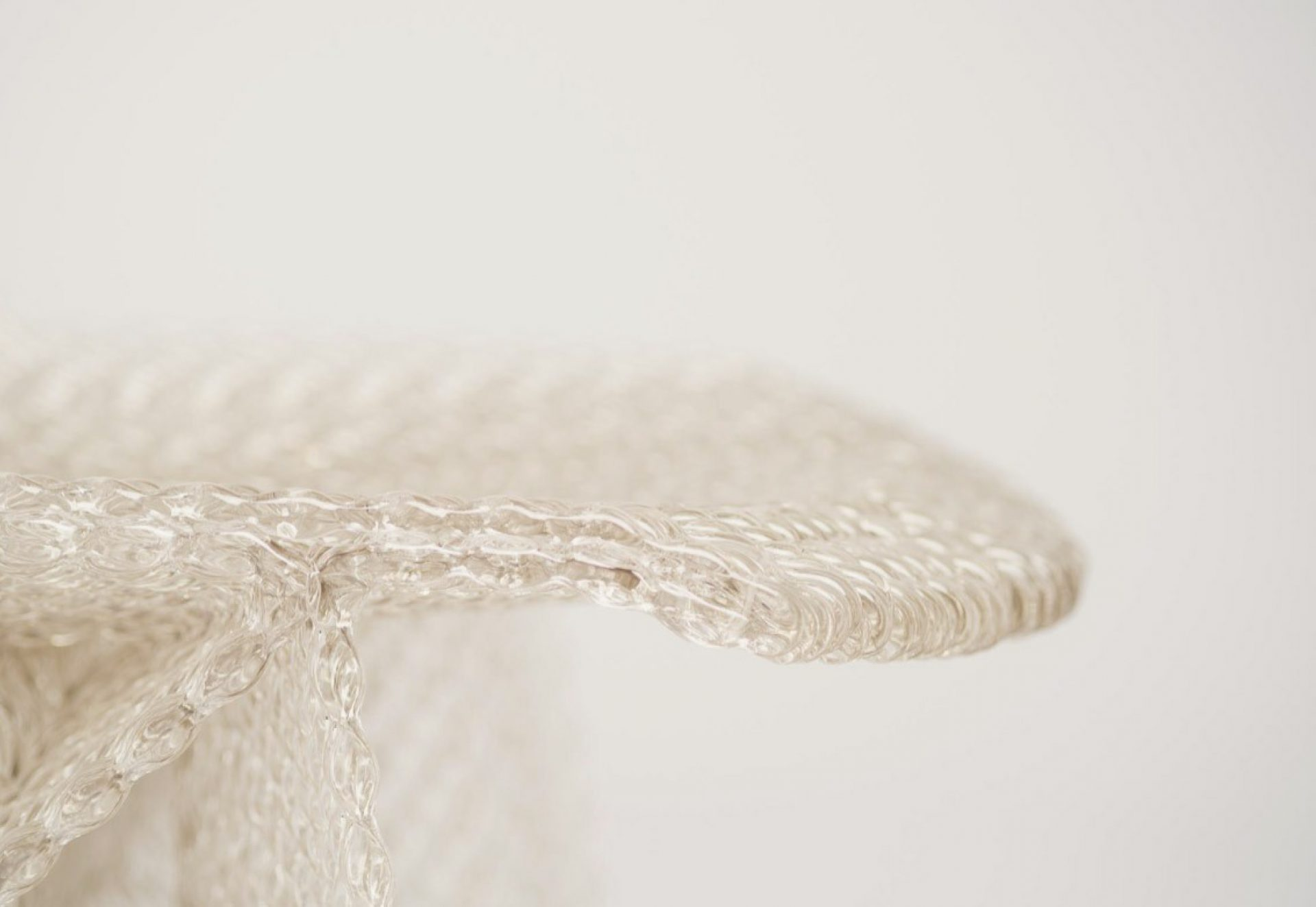 A transparent Endless Chair, extruded from twinkling recycled polycarbonate